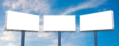 Large billboards against blue sky. 3D rendered illustration.  Stock Image