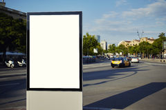 Large billboards standing on a busy street metropolis Royalty Free Stock Photo