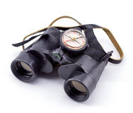 Large binoculars and compass on a white background stock image