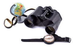 Large binoculars, globe and compass on a white background Royalty Free Stock Photo