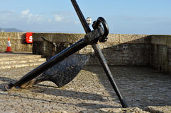 Large black anchor Lyme Regis Dorset. This is the large black anchor on the sea front at Lyme Regis Royalty Free Stock Image