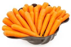 Large black bowl full of ripe and fresh carrots Royalty Free Stock Photo