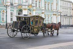 A large black carriage with gold on the Palace square St. Petersburg Russia Stock Photos