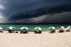 A large black cloud is forming and white beach at Koh Tao, Thailand stock image