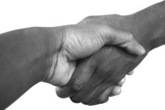 Large Black Handshake grayscale. This is an image of two people handshaking diagonally. (Large Grayscale stock photography