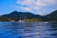 Three Masted Yacht, Zakynthos Greek Island, Greece. A large black hulled three masted yacht anchored off Zakynthos, an Ionian Greek Island, Greece Royalty Free Stock Image