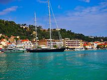 Large Black Two Masted Yacht in Zakynthos Greek Island, Greece. A large black hulled two masted sailing yacht moored in the harbour at Zakynthos, an Ionian Greek Stock Photography