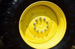 Large Black and Yellow tractor wheel Royalty Free Stock Image