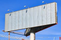 Billboard with blue sky behind it. Large blank billboard with blue sky behind it stock image