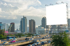 large blank billboard on building in city view background Stock Photography