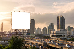 large blank billboard on building in city view background Royalty Free Stock Image