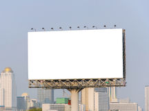 Large blank billboard with city view background Stock Photos