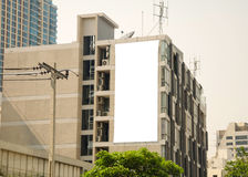 Large blank billboard in city view background Royalty Free Stock Image