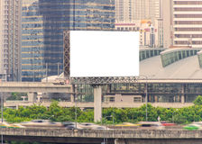 Large blank billboard with city view background.  Royalty Free Stock Photos