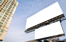 Large blank billboard with city view background.  Stock Photos