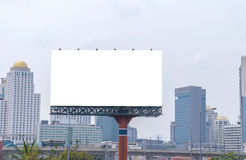 Large blank billboard with city view background. Royalty Free Stock Images