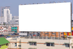 Large blank billboard with city view background. Large blank billboard with city view background Royalty Free Stock Images
