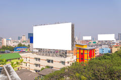 Large blank billboard with city view background. Large blank billboard with city view background Royalty Free Stock Photos