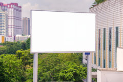 Large blank billboard with city view background Stock Photo