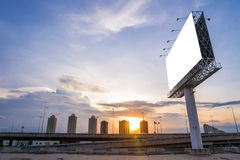 Large blank billboard with city view and background Royalty Free Stock Image