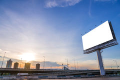 Large blank billboard with city view and background.  Stock Photos