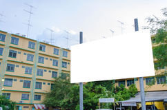 Large blank billboard with city view background.  Stock Image