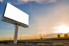 large Blank billboard ready for new advertisement with sunset. Stock Photos