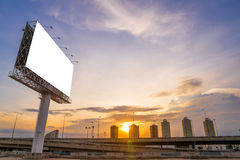 large Blank billboard ready for new advertisement with sunset. Royalty Free Stock Photos