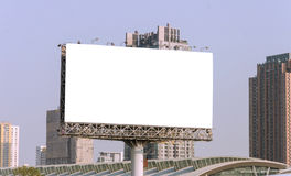 Large blank billboard on road with city view background Stock Images