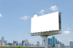 large blank billboard on road with city view background Royalty Free Stock Photo