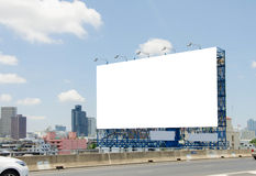 Large blank billboard on road with city view background Royalty Free Stock Photography