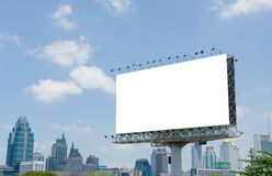 Large blank billboard on road with city view background Stock Image