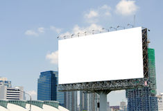 Large blank billboard on road with city view background Stock Photography