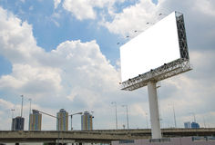 large blank billboard on road with city view background Stock Photos