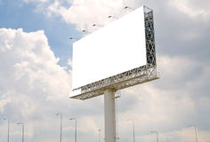 large blank billboard on road with city view background Royalty Free Stock Image