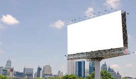 large blank billboard on road with city view background Royalty Free Stock Images