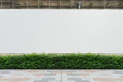 Large blank billboard on a street wall, banners with room to add your own text. Street wall background ,Industrial background, empty grunge urban street with royalty free stock photos