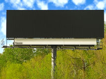 Large blank black billboard. Royalty Free Stock Photos