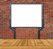 Large blank, empty, white billboard screen  on red brick wall Royalty Free Stock Photos
