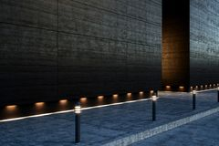 Large blank modern street concrete wall. With lights on sidewalk at night. 3D render Stock Photography
