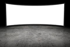 Large blank TV. In dark room Royalty Free Stock Image