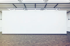 Large blank wall in an art gallery with dark wood floor, toned Stock Photo