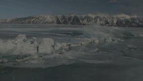 Large blocks of ice crack near Holy Nose Peninsula. Beautiful winter Lake Baikal stock video footage