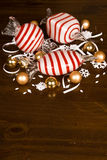 Large Blown Glass Peppermint Candy, Small Christmas Bulbs and snowflakes Royalty Free Stock Photo
