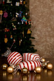 Large Blown Glass Peppermint Candy, Small Christmas Bulbs and snowflakes Royalty Free Stock Photos