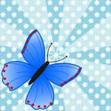 Large blue butterfly on flower meadow and beam pattern. Large blue butterfly on a flower meadow and a beam pattern in a square format Royalty Free Stock Photo