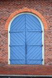 Large Blue Carriage Door in a Red Brick Wall Royalty Free Stock Photos