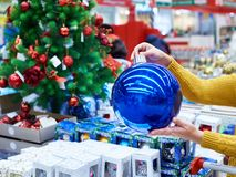 Large blue Christmas tree ball in hands. Large blue Christmas tree ball in female hands Royalty Free Stock Images