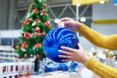 Large blue Christmas tree ball in hands. Large blue Christmas tree ball in female hands Stock Image