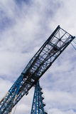 Large blue girders from below, Tees Transporter Bridge, Middlesb. Longest remaining transporter bridge in the world.  Opened in 1911, this bridge is still in Royalty Free Stock Photography
